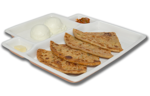 Indian paratha served with pickel and plain yogurt